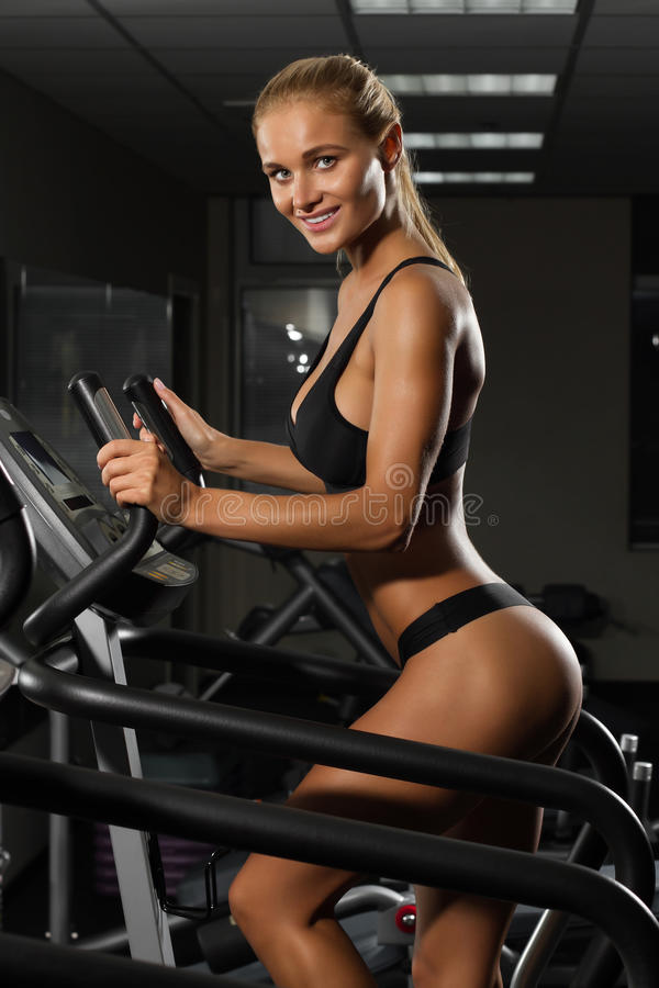 Beautiful young woman doing cardio exercises in fitness clubs stock images
