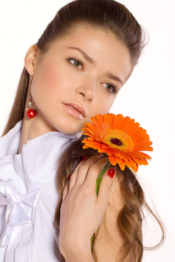 Beautiful young woman with gerber flower. Portrait of Beautiful young woman with gerber flower isolated on white stock image