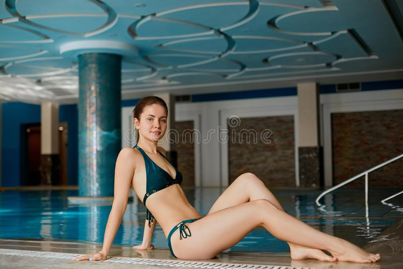 Beautiful Sexy Young Woman, Girl With Healthy Skin In Bikini Relaxing In Swimming Pool Water In Resort Relax Spa Hotel. Holidays V. Acation. Body Health Care royalty free stock image