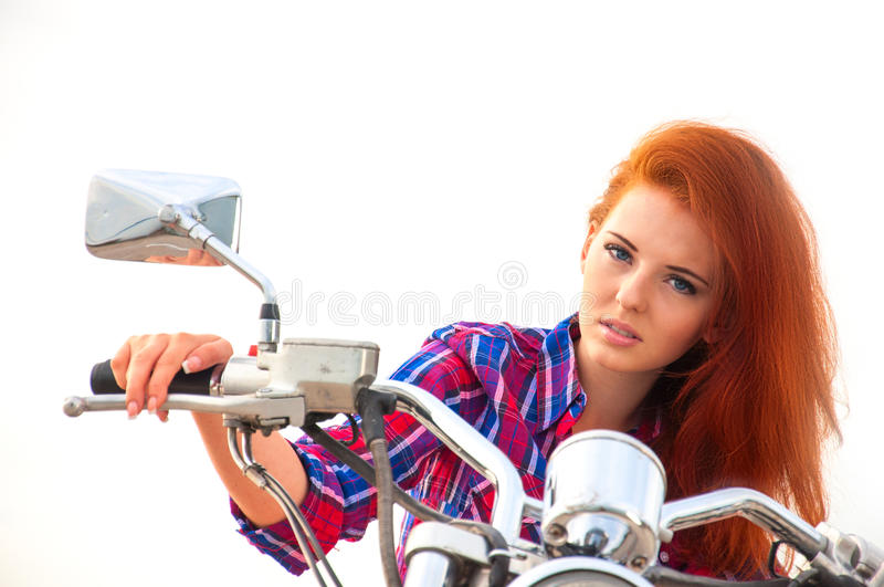 Beautiful, sexy, young woman on a motorcycle stock images
