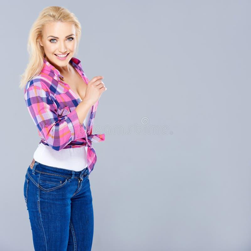 Beautiful shapely busty blond woman stock photo