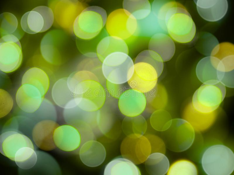 Beautiful shining blurred lights in yellow and green sparkling abstract background vector illustration
