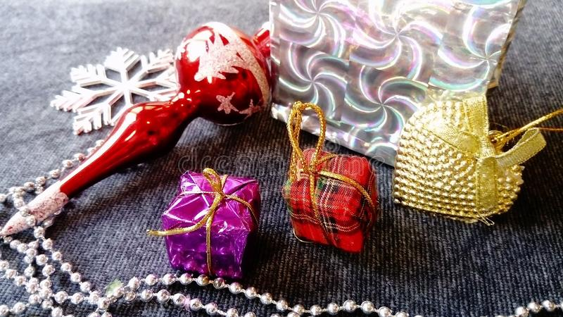 Beautiful shiny Christmas decorations, gifts, packaging, and toys royalty free stock photo