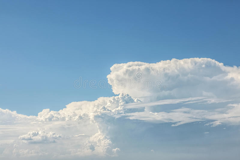 Beautiful shiny cloud. Beautiful cloud formation on a blue sky, perfect for backgrounds royalty free stock image