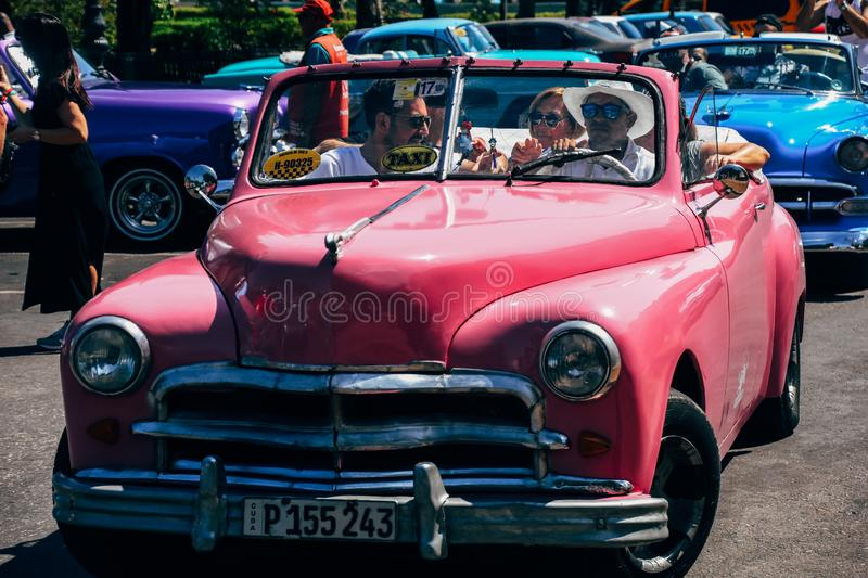 A beautiful pink classic car in Havana, Cuba. royalty free stock photography