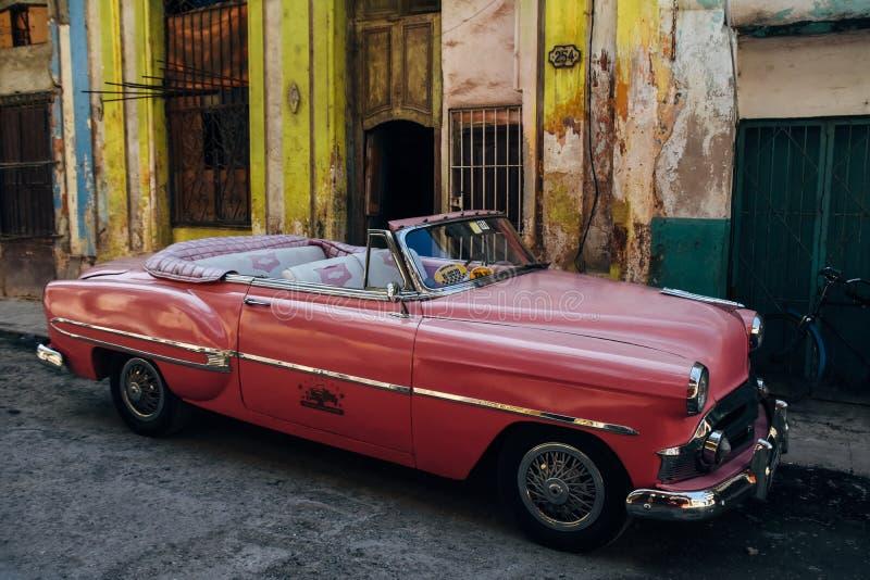 A beautiful classic car in Havana, Cuba. A beautiful shiny red classic car parked in Havana, Cuba royalty free stock photo