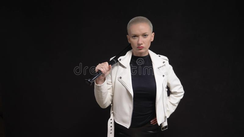 Beautiful  short haired woman in a white leather jacket with a baseball bat stock photos