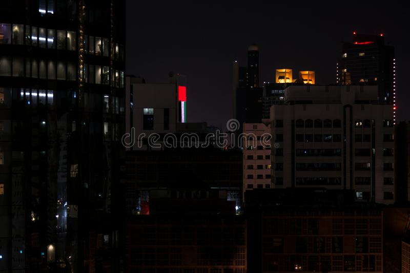 Beautiful shot of Abu Dhabi towers at night with the UAE flag displayed on a screen stock images