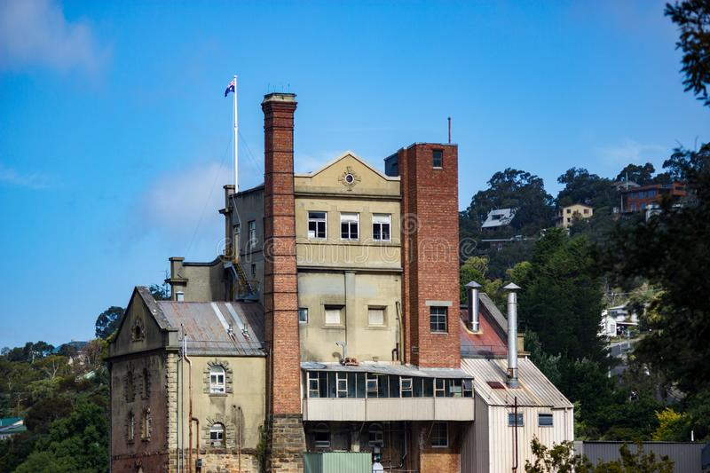 Beautiful shot of a building in South Hobart in Australia with the Australian flag on the roof. A beautiful shot of a building in South Hobart in Australia with royalty free stock photos