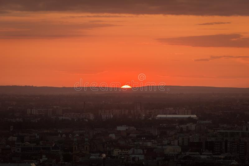Beautiful shot of a city during sunset hour with a glimpse of the burning sun royalty free stock images