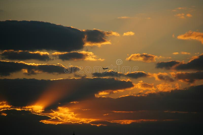 Beautiful shot of the cloudy orange sky during sunset royalty free stock photography