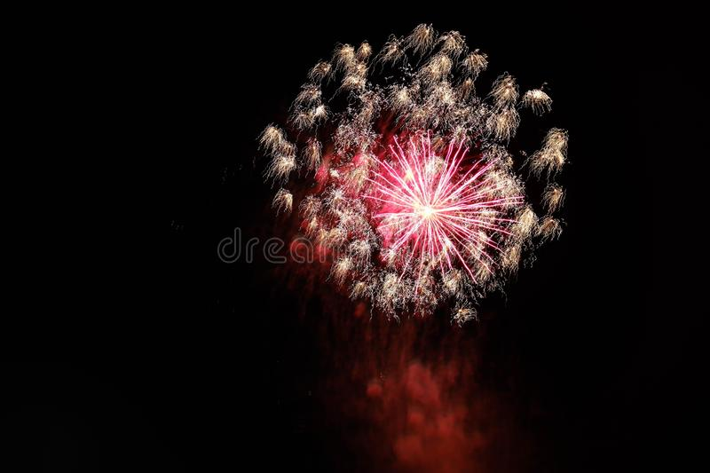 Beautiful shot of colorful erupting and bursting fireworks in the night sky stock photo