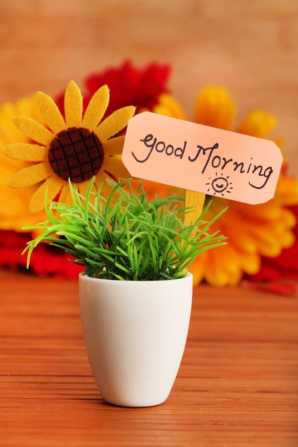 Good morning. Beautiful shot of good morning board stuck in planted pot royalty free stock image