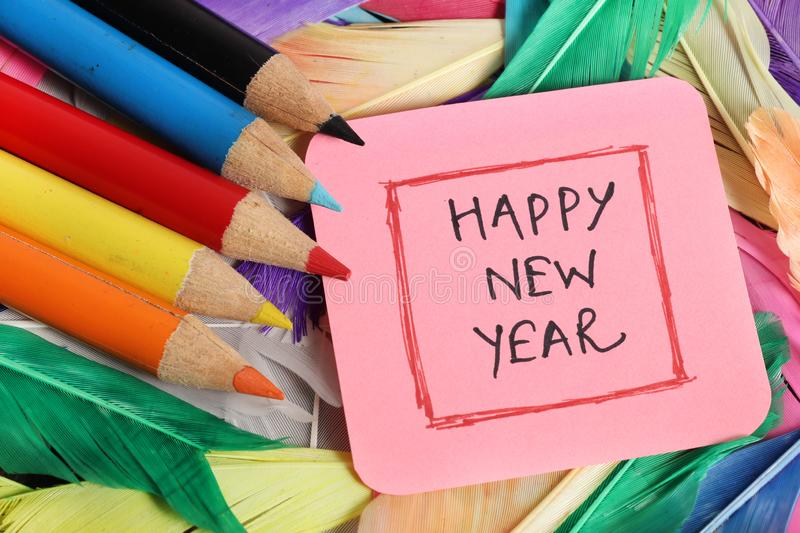 Happy new year. Beautiful shot of happy new year written with colored pencils royalty free stock image