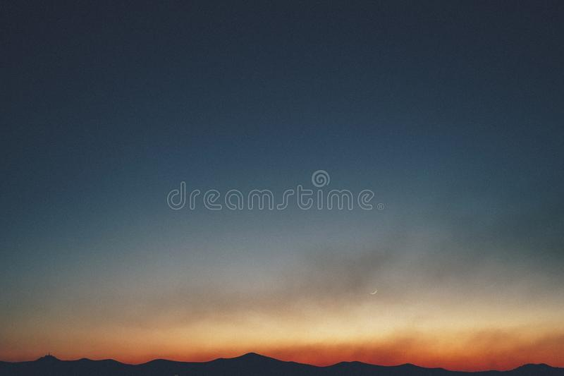 Beautiful shot of the hills with the amazing firey sky in the background at sunset stock photography