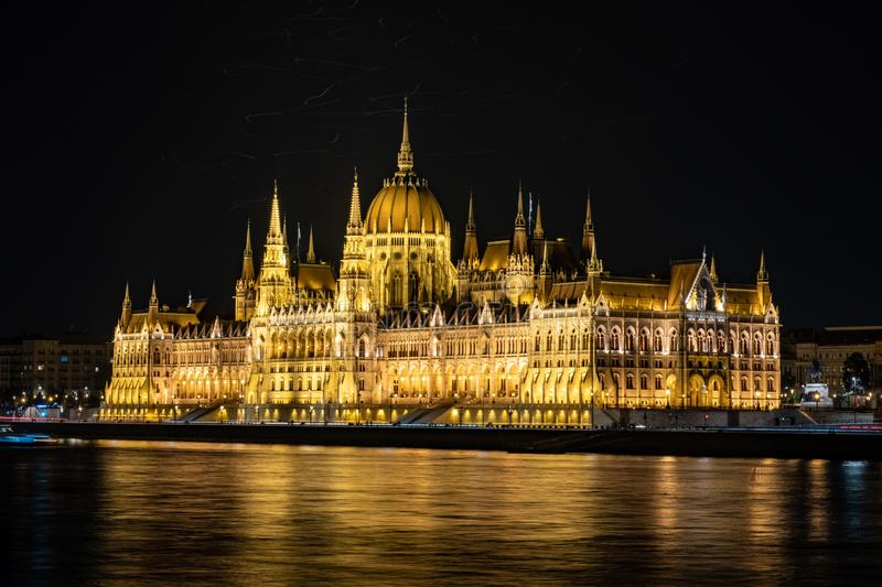 Beautiful shot of The Hungarian Parliament Building with lights at night reflected in the lake stock photos