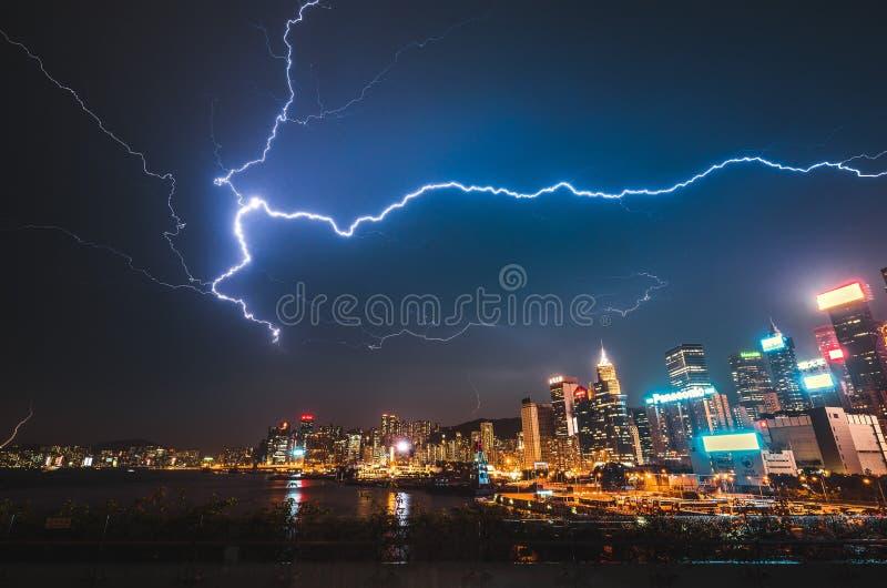 Beautiful shot of a lightning strike over a modern urban city at night stock photos