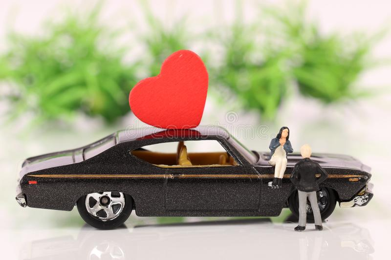 Lovely couple. Beautiful shot of lovely couple with car stock photos