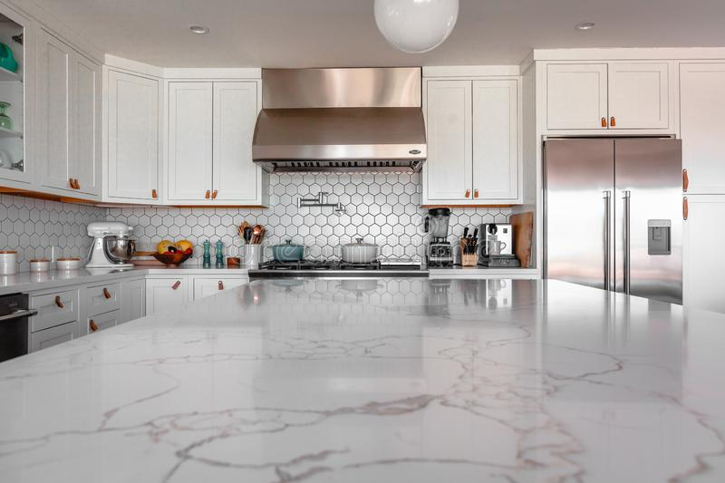 Beautiful shot of modern kitchen interior with various types of kitchenware around stock images