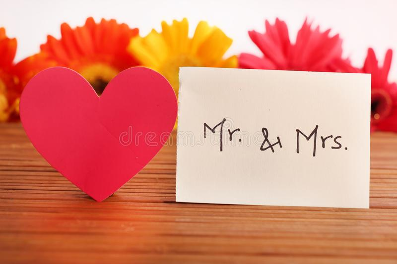 Mr and mrs. Beautiful shot of mr and mrs written on white chit royalty free stock photos