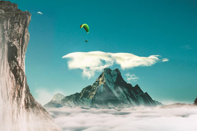 Beautiful shot of a person parachuting off a cliff with a mountain and a clear sky in the background. A beautiful shot of a person parachuting off a cliff with a stock photo