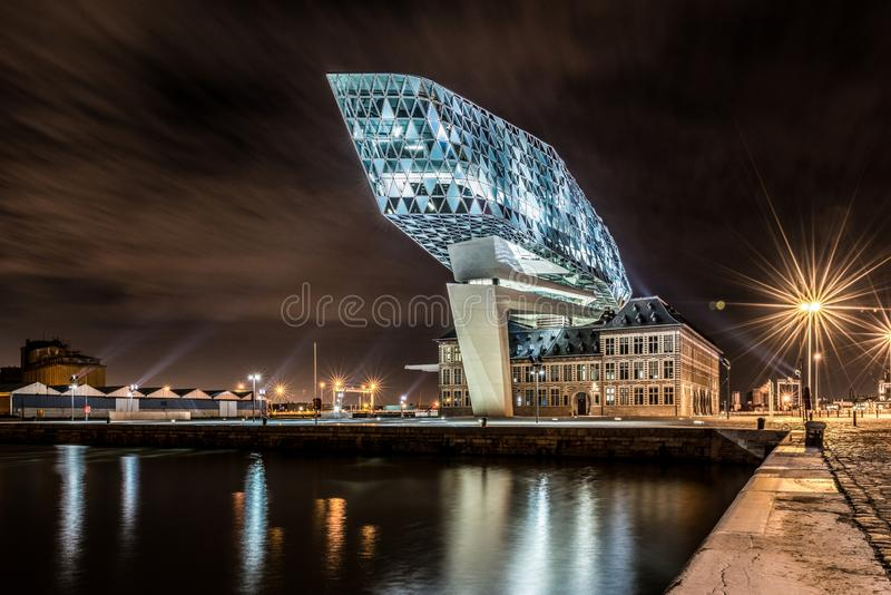 Beautiful shot of the Port Authority Building in Antwerp, Belgium during night time. A beautiful shot of the Port Authority Building in Antwerp, Belgium during royalty free stock photo