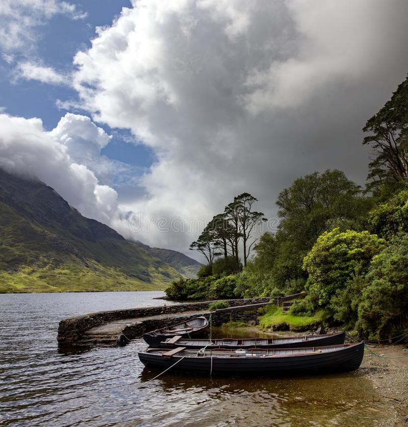 Beautiful shot of rowing boats in the river of Doo Lough, County Mayo in Ireland. A beautiful shot of rowing boats in the river of Doo Lough, County Mayo in royalty free stock images