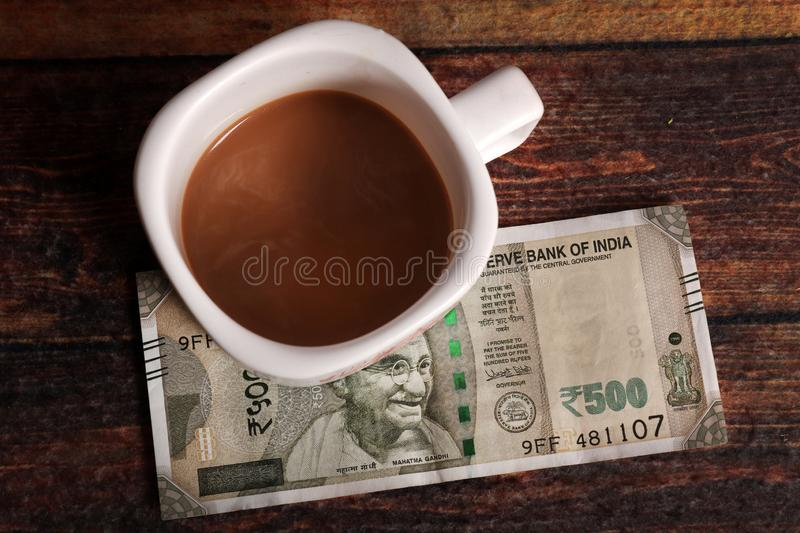 Tea and money stock photography