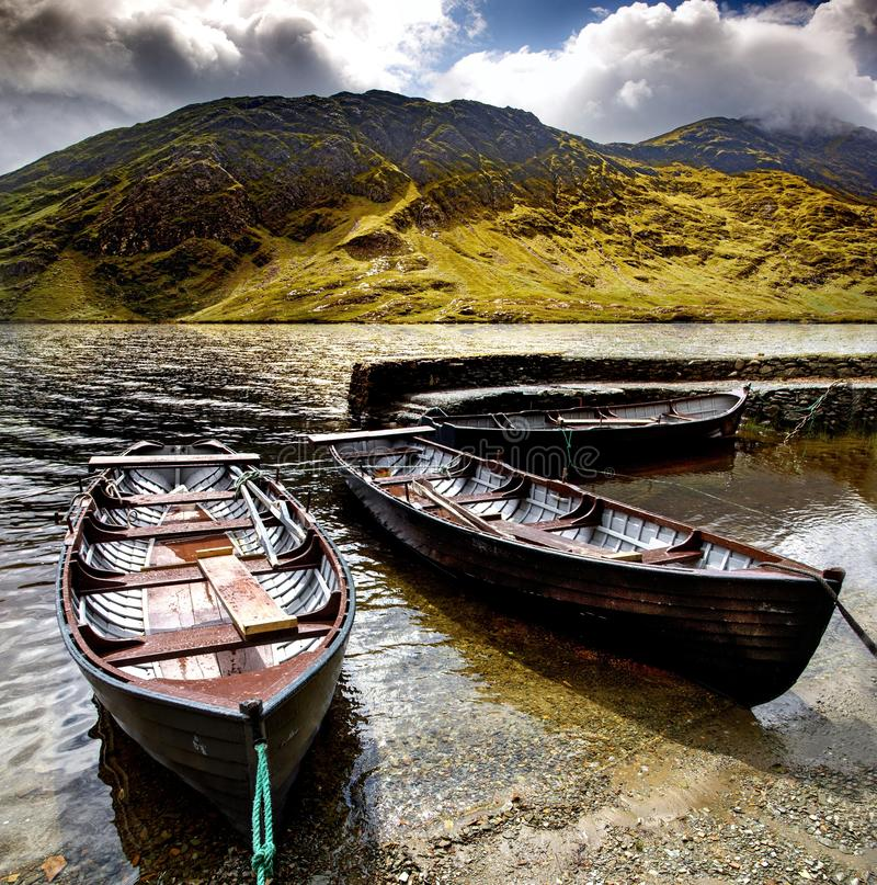 Beautiful shot of three Doo Lough rowing boats with the Irish Sheeffrey Hills in the background. A beautiful shot of three Doo Lough rowing boats with the Irish royalty free stock photos