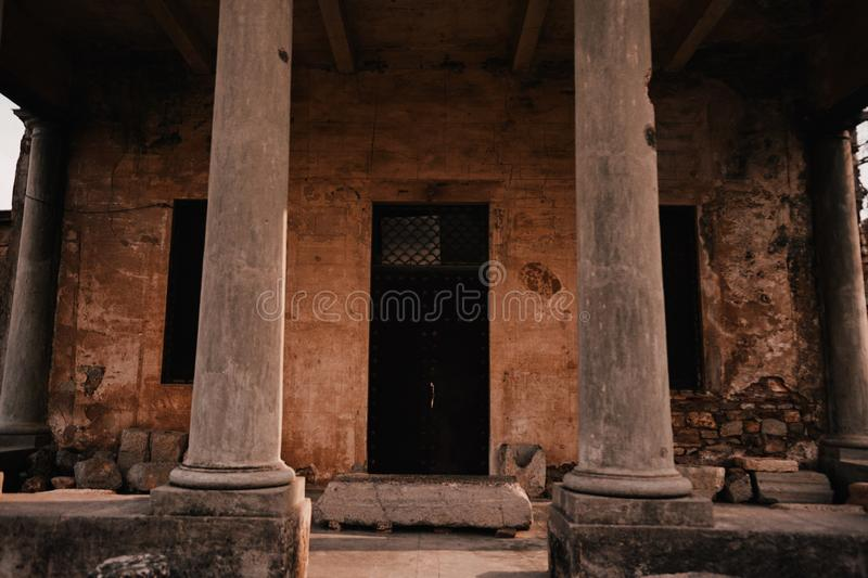 Beautiful shot of two brown concrete pillars of an old stone temple stock image