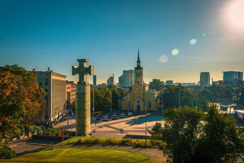 Lens flare and Monuments in Tallin, Estonia. Beautiful, shun shiny day in Tallinn Estonia. Pictured center in the foreground is a large glass block memorial of a royalty free stock photos