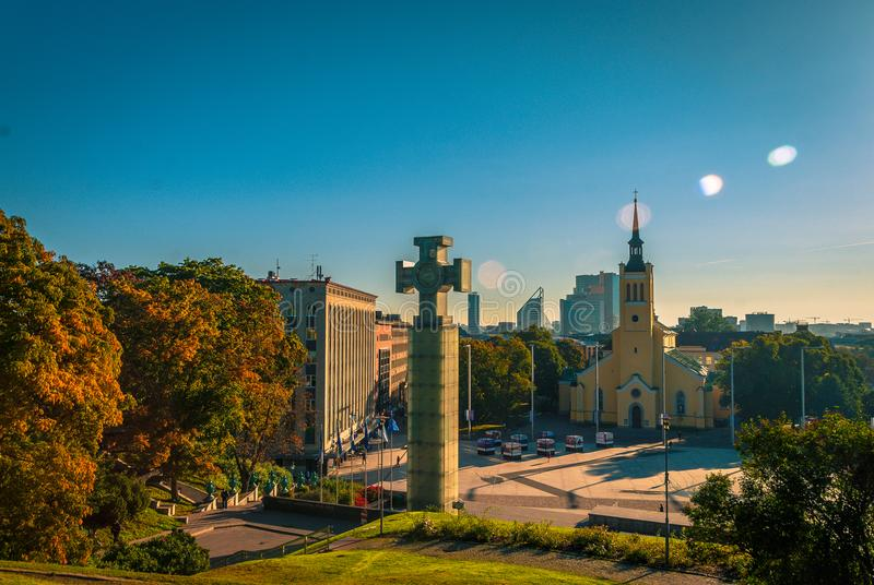Lens flare and Monuments in Tallin, Estonia. Beautiful, shun shiny day in Tallinn Estonia. Pictured center in the foreground is a large glass block memorial of a stock photography