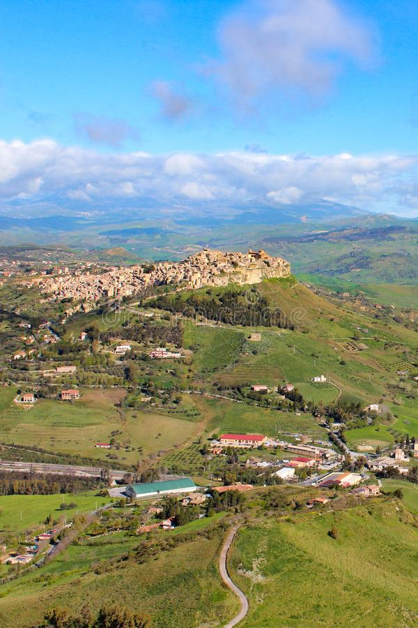 Beautiful Sicilian village Calascibetta photographed from nearby Enna with adjacent mountains and green landscape. Amazing. Landscapes in Italy. Italian travel royalty free stock images