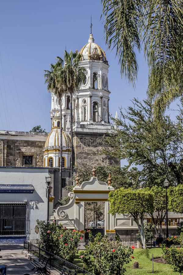 Beautiful side view of the church of San Pedro Apóstol. In a wonderful and sunny day in Tlaquepaque Jalisco Mexico royalty free stock image