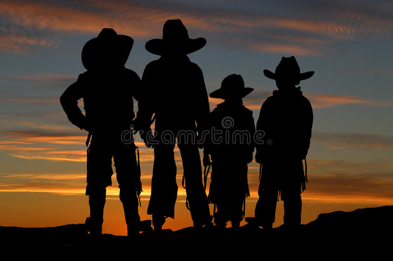 Download Beautiful Silhouette Of Four Young Cowboys With A Sunset Backgro Stock Image - Image: 37886941