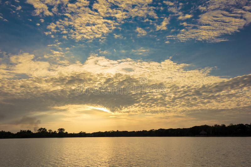 Beautiful silhouette sunset and clouds at the lake. stock image