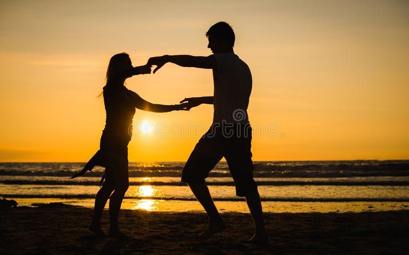 Beautiful silhouettes of dancers at sunset royalty free stock photo