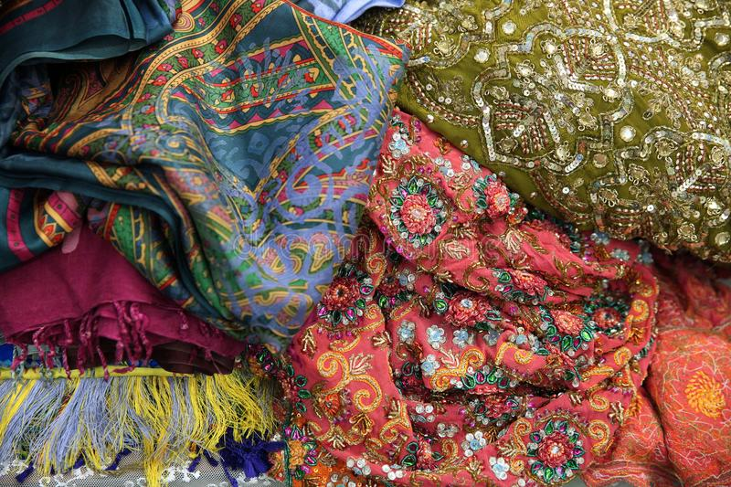 Beautiful silk fabric and embroidered with beads at the flea mar royalty free stock photos