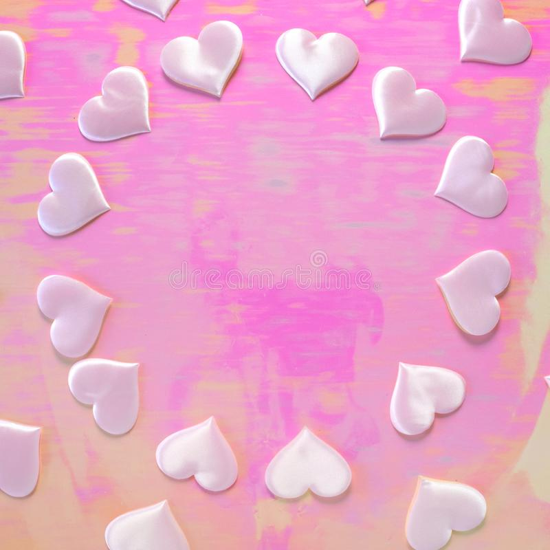 Beautiful silk pink hearts on a pink background. Holiday concept Valentine`s Day. Flat lay. royalty free stock photo