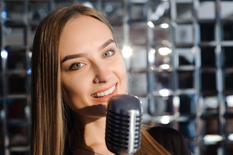Beautiful Singing Girl. Beauty Woman with Microphone. Glamour Model Singer. Karaoke song. stock images