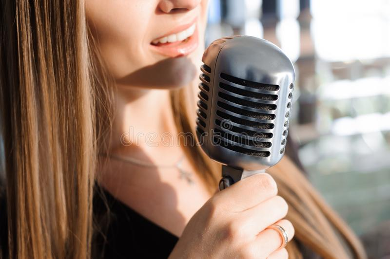 Beautiful Singing Girl. Beauty Woman with Microphone. Glamour Model Singer. Karaoke song stock images