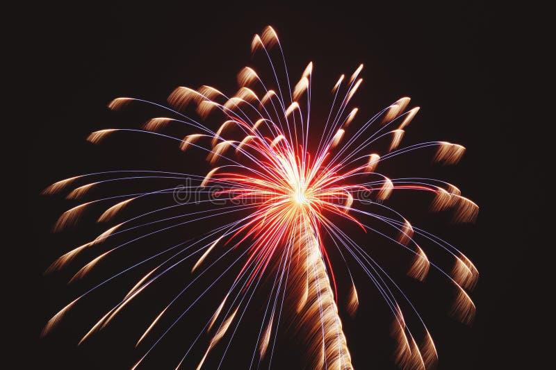 Beautiful single firework. Dark sky with beautiful single beautiful blue and orange firework for celebration royalty free stock photos