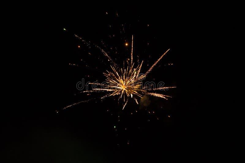 Beautiful single Firework isolated on black background. Beautiful single Golden firework isolated on black background. Firework explode night. Template to design stock image