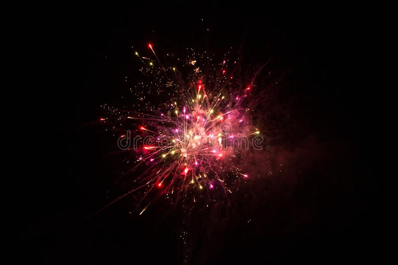 Beautiful single Red Firework isolated on black background. Beautiful single colorful firework isolated on black background. Firework explode night sky. Template royalty free stock image