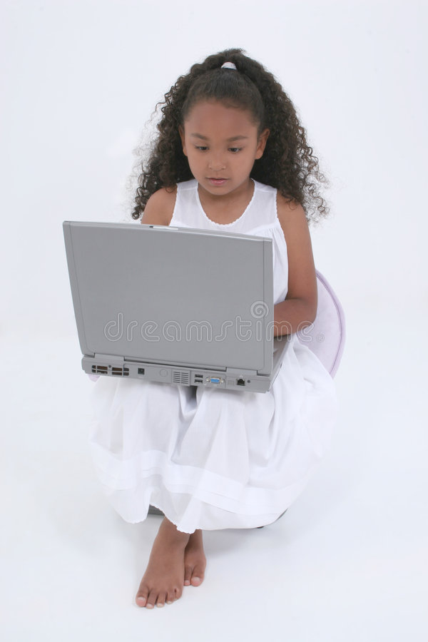 Beautiful Six Year Old Girl With Laptop Over White royalty free stock photos