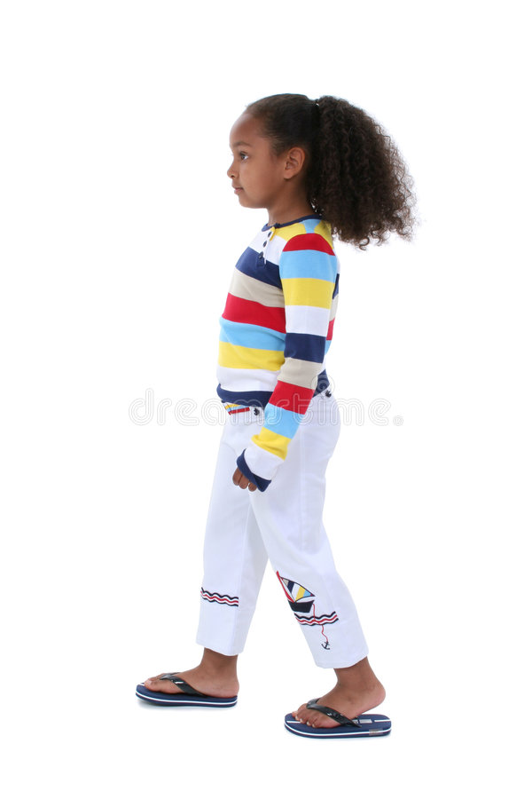 Beautiful Six Year Old Girl Walking Profile In Summer Clothes stock image