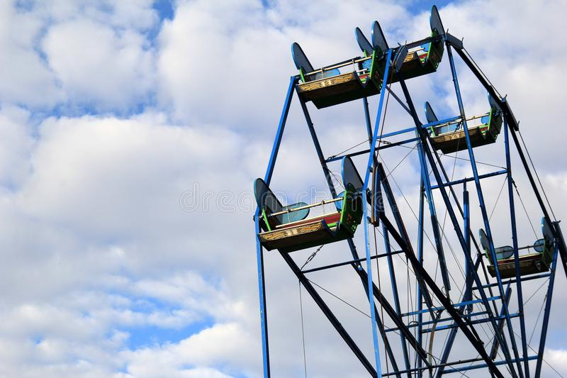 Beautiful skies filled with puffy white clouds are backdrop to Ferris wheel, York`s Wild Kingdom, Maine, 2017 royalty free stock photos