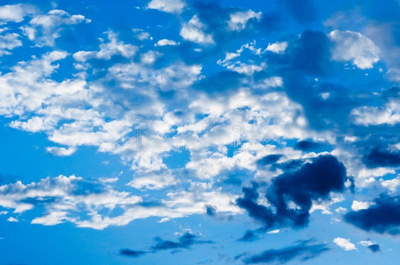 Early evening. Beautiful blue sky. Light air clouds. stock photo