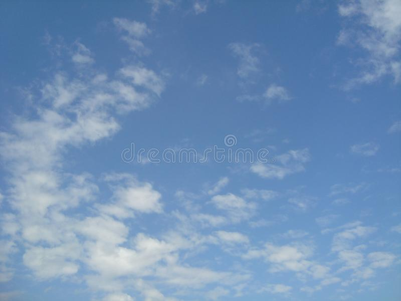 Beautiful sky Blue sky Blue fluffy white clouds background royalty free stock photography