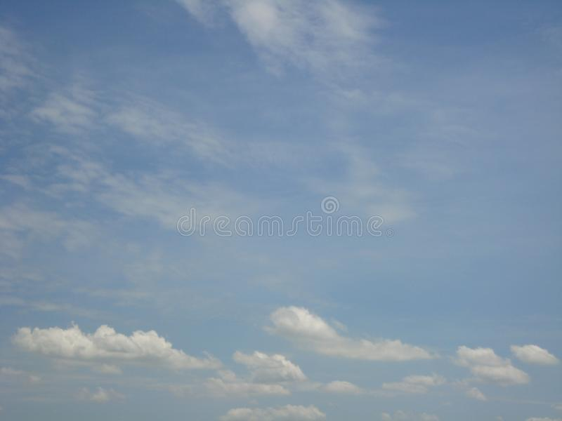 Beautiful sky Blue sky Blue fluffy white clouds background royalty free stock photo